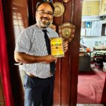 """TagorePrize's member of the advisory board Yvette Rosser aka Ram Rani donating a copy of """"One Hundred Poems of Kabir"""" to Himalayas, to Mark Medley, Principal at Saint Andrews School in Bhowali, Uttarakhand, India – April 30th, 2019."""
